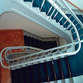 Adaptech, Inc Curved Stairlifts